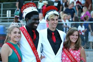 The 2013-14 Homecoming King (Max La Capria), Queen (Adela Weigel), Prince (Sam Van Pykeren) and Princess (Emily Holmes)