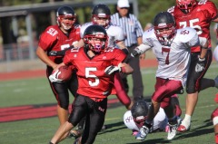 Kjell Johnson running the ball during the Homecoming game against Santa Cruz.
