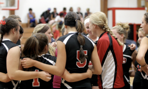 The Varsity girls coming together before a game. Photo From: MVP Photography