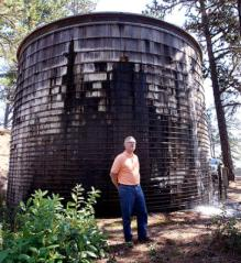 An SLV 100,000 gallon redwood tank installed in 1972, now leaking heavily from rot. Photo From: Santacruzsentinel.com