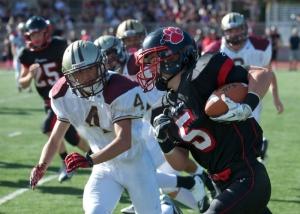 Captain Kjell Johnson running the ball. Photo From: Mbaypreps.com