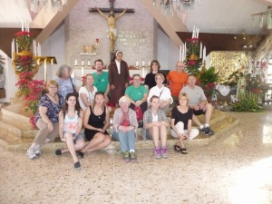 The delegation members in the church where Oscar Romero was assassinated. Source: Jesse McMIlan